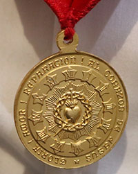 A new Guard of Honor wears the medal of the Guard of Honor that features an image of the Sacred Heart of Jesus.