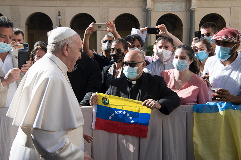 Pope Francis greets a group from Venezuela during his weekly general audience in the Paul VI Hall at Vatican City on Aug. 25, 2021.