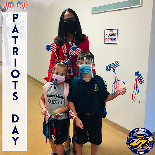 Principal Teresita Wardlow poses with a couple of St. Mark students holding up flags to mark Patriots Day, this year leading up to the 20th anniversary of the Sept. 11 attacks.