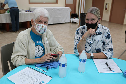 Libby Johnson, left, and Myra Puccio attend the Sidewalk Advocacy Training Sept. 11, 2021 at the Madonna Retreat Center in West Park. Johnson is a retired delivery room nurse. She was there to learn how to be an effective sidewalk advocate near an abortion clinic where she has prayed for the past six years.