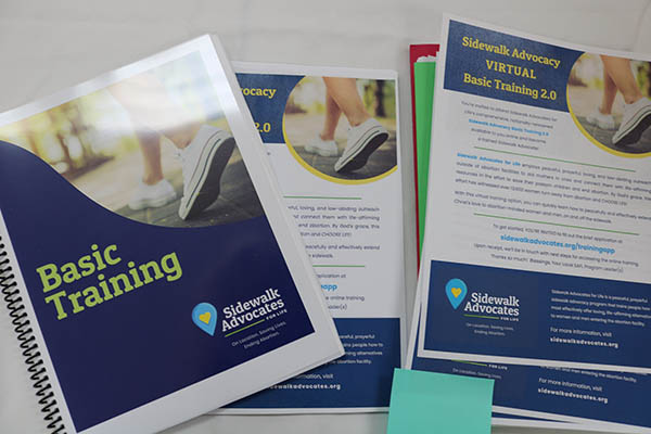 Training materials are displayed on tables as part of the Sidewalk Advocacy Training offered Sept. 11, 2021 at the Madonna Retreat Center in West Park.