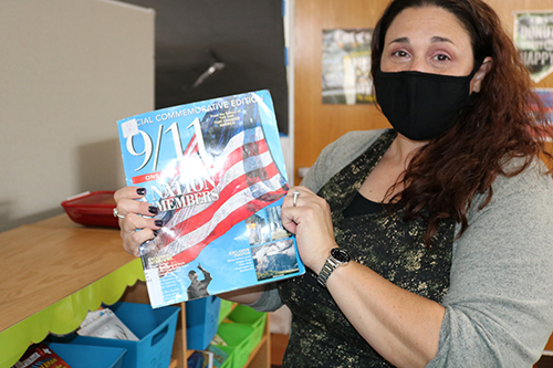 Tara Bartos, a librarian and technology and media specialist at St. Ambrose School, talked with her students about 9/11 and shared stories about her family members in New York at the time.