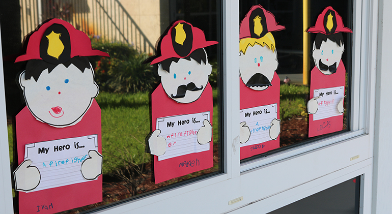 Pieces of art designed by first-graders at St. Ambrose School are displayed around the campus for all to enjoy.The project was part of events the school participated in to reflect on the 20 anniversary of 9/11.