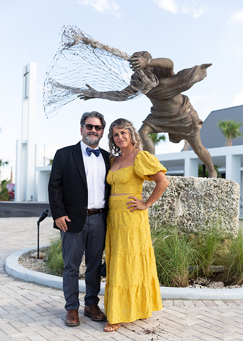 Juan Calvo, from Oppenheim Architecture who designed the new St. Peter the Fisherman Church in Big Pine Key, and his artist-wife, Natalie Plasencia, who created much of the new religious artwork there, stop for a picture in front of her sculpture of St. Peter casting his net prior to the dedication Mass Sept. 25, 2021. The newly completed church, parish hall and priests' residence in the Lower Florida Keys replace the old facility which was mostly destroyed by 2017's Hurricane Irma.