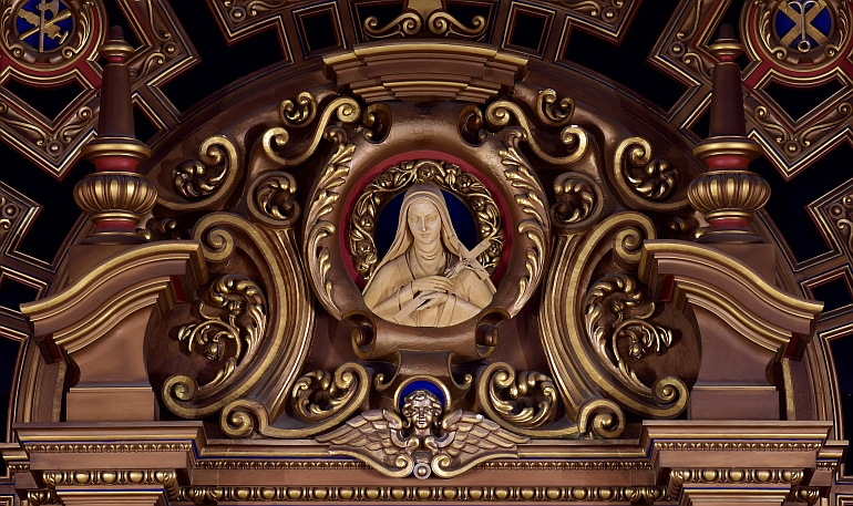 Elaborate scrollwork frames a portrait of St. Therese at Little Flower Church in Coral Gables.