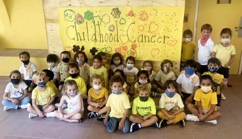 PreK-4 class decks out in gold for Childhood Cancer Awareness Month at St. Agnes Academy.