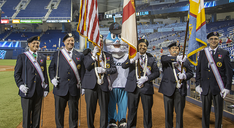 """Members of the Knights of Columbus Color Guard from different assemblies throughout the state participated at the beginning of the final Marlins game of the season at LoanDepot Park in Miami. Before the game, faithful had gathered at the stadium for the first ever """"Mass at the Park,"""" Oct. 3, 2021."""