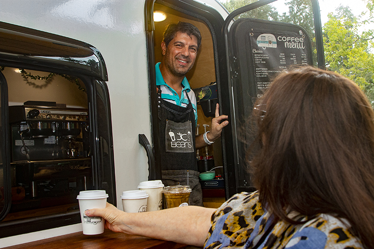 Demian Bowman, owner of JC Beans Mobile Cafe, provides a caffeinated break to archdiocesan employees when he stopped by the Pastoral Center on Oct. 1, 2021, International Coffee Day.