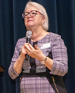 Grace Veloz, director of Stewardship for the archdiocesan Office of Development, speaks to the more than 250 volunteers and parish staff who gathered at Belen Jesuit Prep Oct. 2, 2021, for the Stewardship and Ambassadors of First Impressions Day.
