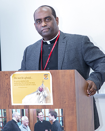 Father Reginald Jean-Mary, pastor of Notre Dame d'Haiti Mission in Miami, leads one of the Creole-language sessions at the Stewardship and Ambassadors of First Impressions Day, hosted by the Office of Development and held at Belen Jesuit Prep Oct. 2, 2021,