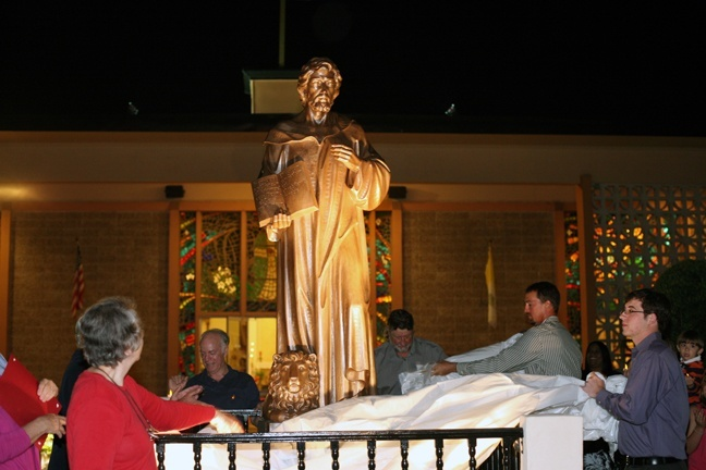 Parishioners unveil the newly-bronzed statue of St. Jerome.