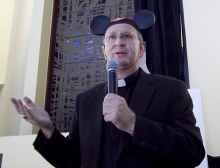 Payback for a prankster: Bishop Noonan wears his Mickey miter during the farewell lunch and roast thrown by Pastoral Center employees.