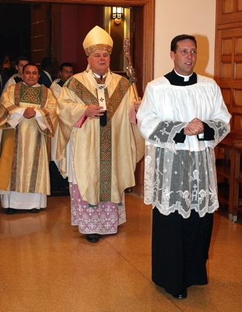 Archbishop Thomas Wenski enters into the Cathedral of St. Mary for the celebration of midnight Mass on Christmas.