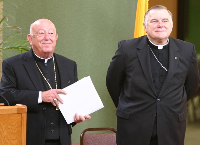 Archbishop-designate Thomas Wenski, currently bishop of Orlando and formerly a Miami priest and auxiliary bishop, stands next to Archbishop John C. Favalora, left, at the start of the press conference where it was announced that he had been named fourth archbishop of Miami.