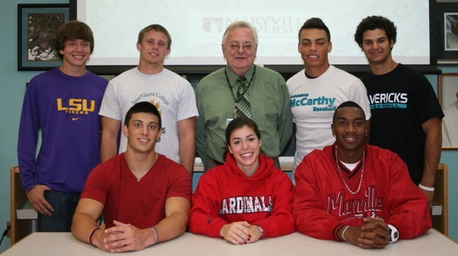Archbishop McCarthy High School student athletes smile broadly following the annual athletic spring scholarship signing ceremony. 