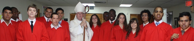 The confirmandi pose for a picture with Auxiliary Bishop John Noonan.