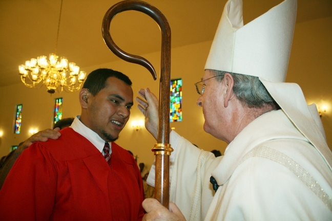 Alvaro Rivera is anointed by Auxiliary Bishop John Noonan.