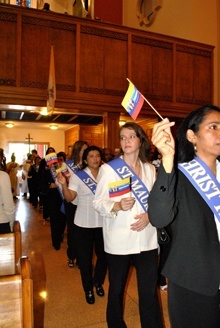 Members of La Cofradía de Nuestra Señora de Chiquinquirá enter St. Mary Cathedral wearing sashes bearing the names of the parishes to which they belong. The cofradía, or guild, is present in 30 parishes in the Archdiocese of Miami.