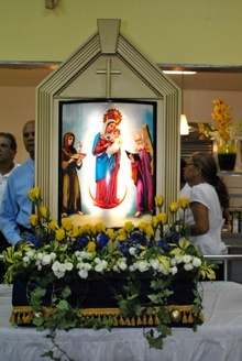 An image of Our Lady of Chiquinquirá is on display at the reception which followed the Mass.