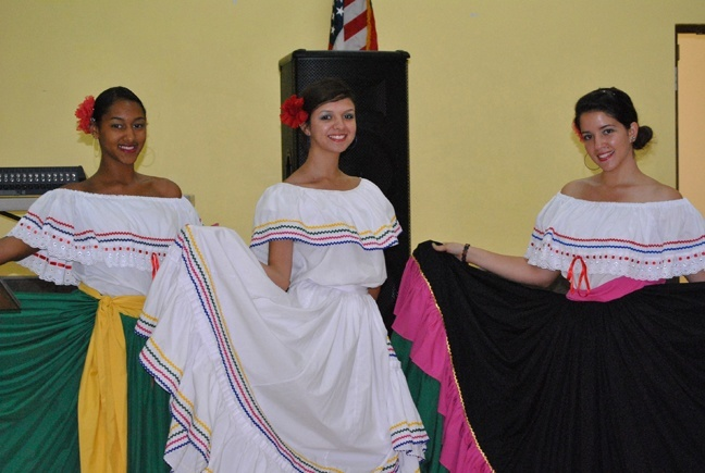 Colombian dancers, from left, Cynthia Baez, Ana Guerrero and Giuliana Toscani, show off their folkloric outfits.