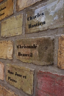 The names of the dead are written on the bricks that make up perhaps the only monument in Haiti built to honor the victims of the Jan. 12 earthquake.