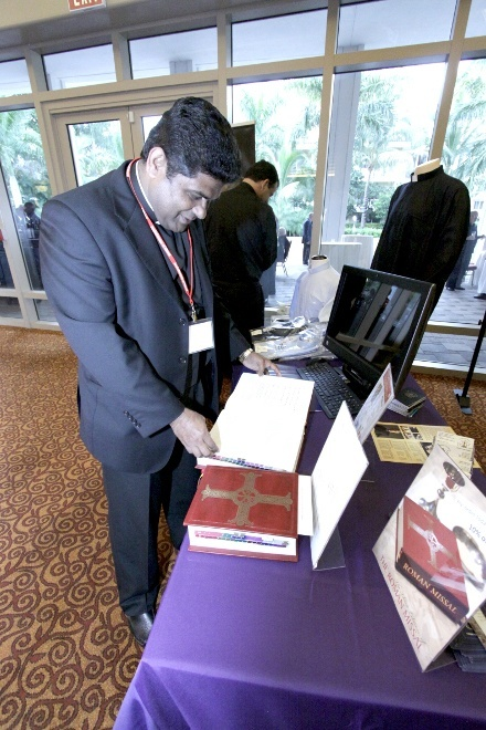 Father George Packuvetthara, parochial vicar at St. David Church in Davie, checks out the new English translation of the Roman Missal.
