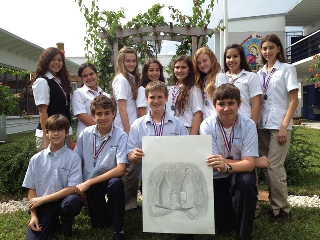 Blessed Trinity eighth grade academic olympians pose with winning art work.