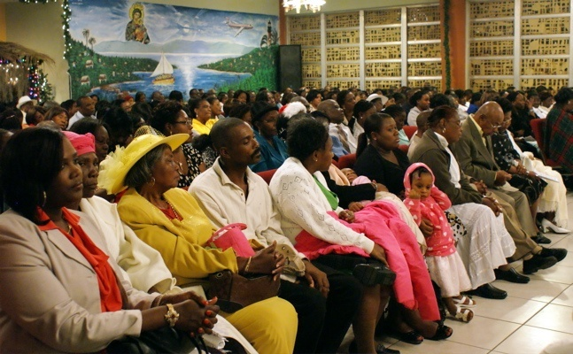Notre Dame d' Haiti Mission was filled for midnight Mass on New Year's eve; the Mass itself was offered for peace and healing in the world and in particular for the people of Haiti.