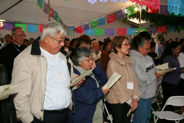 Pat Stockton, third from left, one of the co-founders of the National Catholic Farmworker Network and longtime director of farmworker ministry in the Archdiocese of Miami, takes part in the organization's 25th anniversary meeting in Sacramento at the end of October. At left are Ruben and Maria Marques from Immokalee, Fla., who were farm workers themselves and have been very involved in supporting the presence of the Church among farm workers for many years.