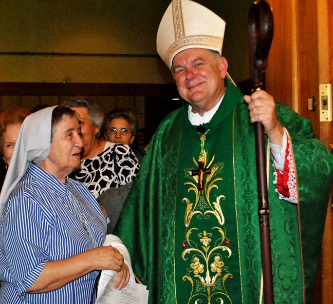 Archbishop Wenski speaks with Claretian Sister Carmen Alvarez, who was present at his first Mass as a priest 35 years ago. During Mass, he introduced Sister Alvarez as one of his oldest - in longevity of time, not age - friends in the archdiocese.