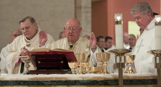 Archbishop John C. Favalora recites the eucharistic prayer. At left is Archbishop Thomas Wenski and at right is Archbishop Favalora's Rome classmate, also celebrating 50 years in the priesthood, Msgr. William Hennessey.
