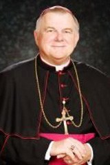 Archbishop Thomas Wenski, betting Key lime pie, Fort Lauderdale sand and cigars, on the Miami Heat
