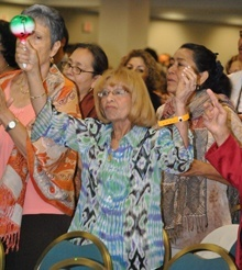 Virginia Nunez of St. Edward Parish in Pembroke Pines shakes a maraca to the beat of the music.