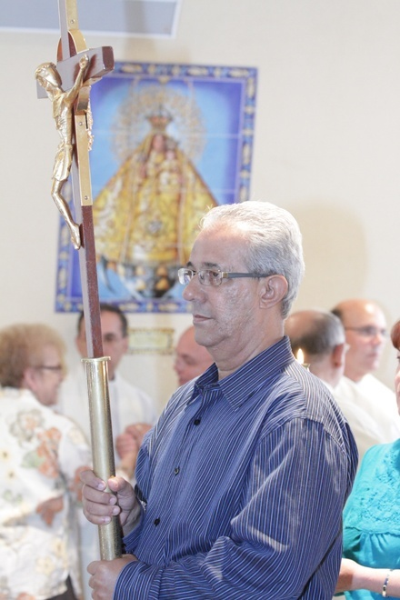 Justo Luis Rodriguez of the Diocese of Pinar del Rio in Cuba carries the processional cross into the Shrine of Our Lady of Charity.