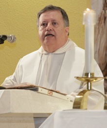 Father Juan Sosa, pastor of St. Joseph Parish on Miami Beach, preaches the homily during the July 14 Mass.