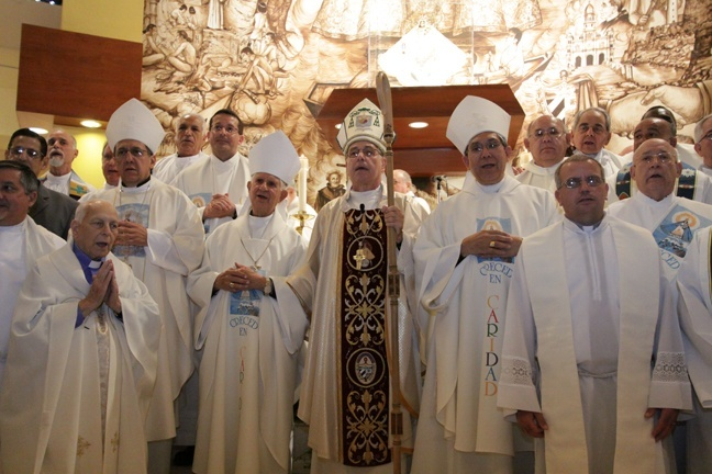 Cuban priests and bishops working on the island and in the U.S. pose for a picture inside the Shrine of Our Lady of Charity after Mass.