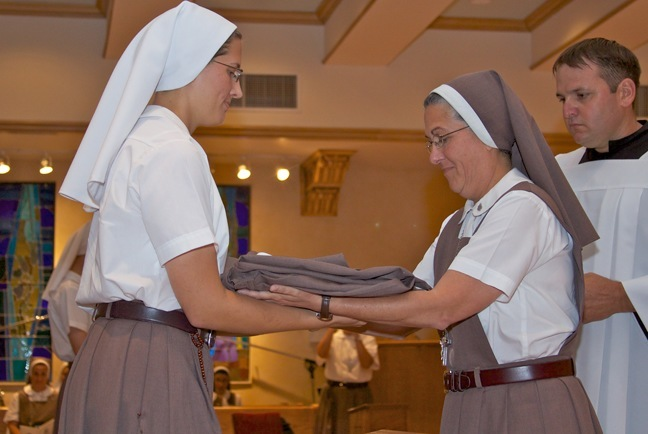 Sister Grace Marie of the Triumph of Crucified Love receives her habit and veil from Mother Adela Galindo, foundress of the Servants of the Pierced Hearts of Jesus and Mary.