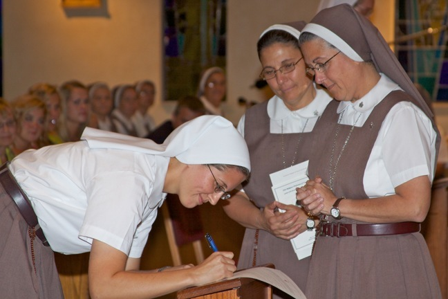 Sister Grace Marie of the Triumph of Crucified Love, left, was one of two women who finished their formation and entered the Institute of the Servants of the Pierced Hearts of Jesus and Mary July 11.