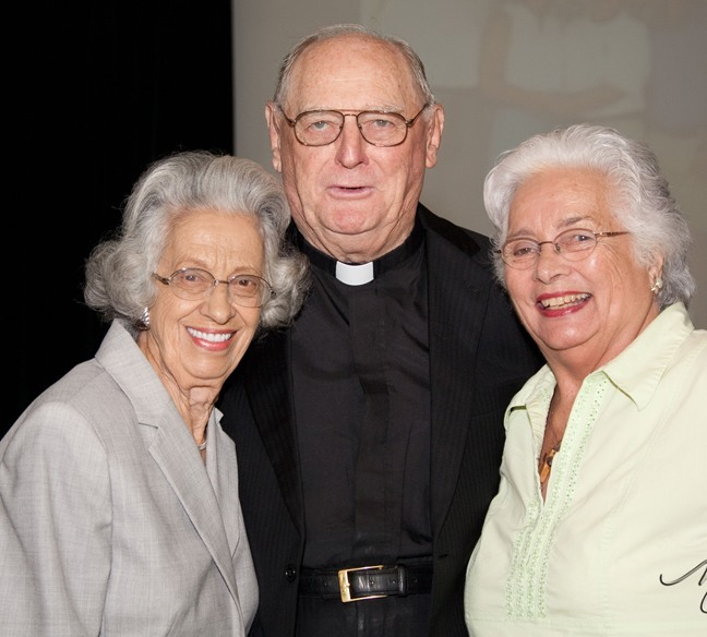 Msgr. Noel Fogarty poses after his retirement Mass with Ann Schandelmayer and Connie Sessions, who have been parishioners at St. Gregory since the 1960s.
