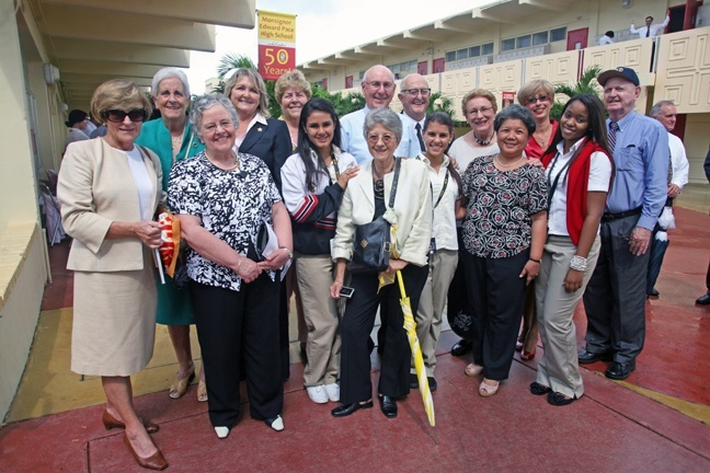 Members of the Teresian Association, who taught at Pace for three decades beginning in 1961, pose for a photo after the 50th anniversary Mass along with some current students, current principal Ana Garcia (third from right) and Marist Brothers who also taught at the school from the very beginning.