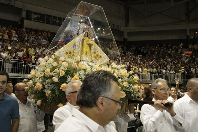 The image of Our Lady of Charity brought from Cuba 50 years ago processes around the BankUnited Center.