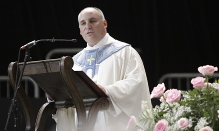 Father Rumin Dominguez, rector of the shrine, preaches the homily.