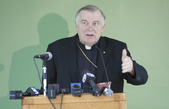 Archbishop Thomas Wenski speaks to the media regarding the archdiocese's decision to file a lawsuit in federal court against the Health and Human Services mandate that would require the Church and its entities to provide contraception and sterilization and abortion-inducing drugs as part of its health care coverage for employees.