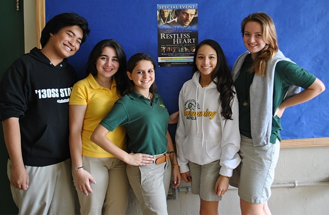 Key Club members get together to promote the screening of Restless Heart Oct. 27. From left: Steven Coward, senior; Natalie Lopez, Key Club vice president and a senior; Xiomara del Corral, club president, junior; Maria Poveda, junior, and Anna Eakins, junior.