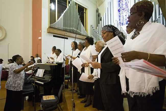 Members of the choir from predominantly black Holy Redeemer and St. Philip Neri parishes sing at the Mass.