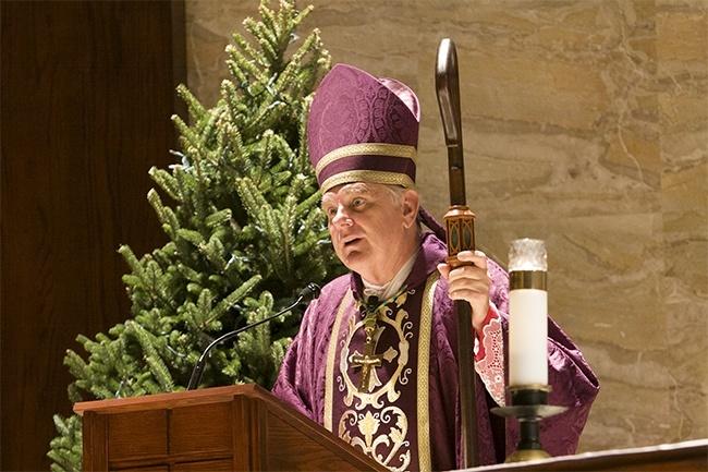 Archbishop Thomas Wenski preaches the homily to Pastoral Center employees.