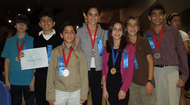 From left, Blessed Trinity students who received 1 Superior Award, 7 Awards of Excellence and 1 Honorable Mention at the South Florida Regional Science and Engineering Fair: Sebastian Plasencia, Jon Rodriguez, Alejandro Aloma, Daniella Diaz, Daniela Rodriguez, Sebastian Ortiz, Alejandro Carrillo, not pictured:  Kristina Moya and Maria Elena Petrovich.