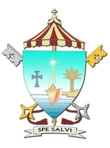 The Coat of Arms for the Basilica of St. Mary Star of the Sea, Key West: Based on the coat of arms of the Archdiocese of Miami, the position of the sand indicates that this parish was the beginning of the Archdiocese of Miami and is at the end of it. The conch shell is the conventional symbol of Key West. Of course, the star is for the parish's patroness. Below the cross and above the ombrellino is a conch pearl. The motto: Pope Benedict XVI introduced his second encyclical letter with the title,