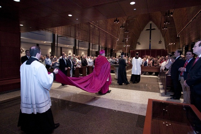 Wearing the cappa magna (large cloak) that once belonged to Miami's first archbishop, Coleman Carroll, Archbishop Thomas Wenski enters Epiphany Church to celebrate Pontifical High Mass in the extraordinary form of the Latin rite.