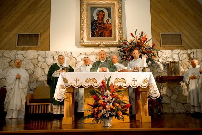 Cardinal Stanislaw Dziwisz celebrates Mass in Polish at Our Lady of Czestochowa Mission in Pompano Beach, accompanied by Archbishop Thomas Wenski and the Polish priests who staff the mission.